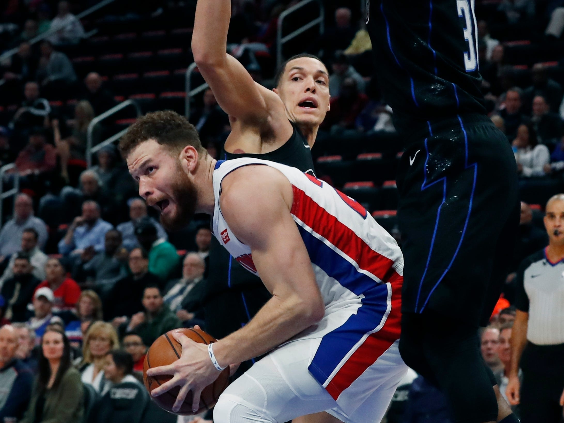 Detroit Pistons forward Blake Griffin (23) looks to shoot as Orlando Magic forward Aaron Gordon and guard Terrence Ross (31) defend during the first half.