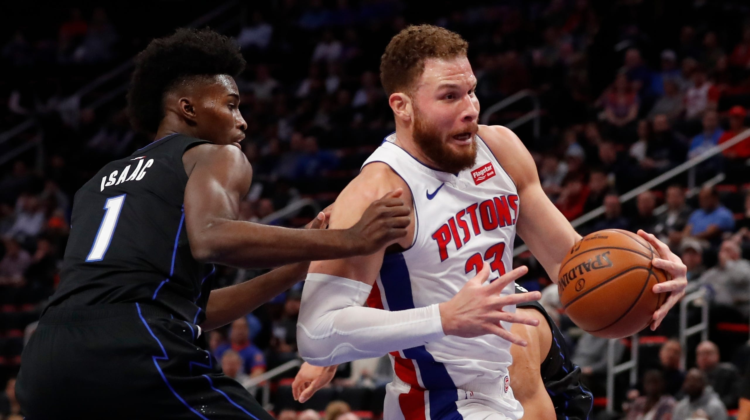Detroit Pistons forward Blake Griffin (23) drives as Orlando Magic forward Jonathan Isaac (1) defends during the first half on Wednesday.