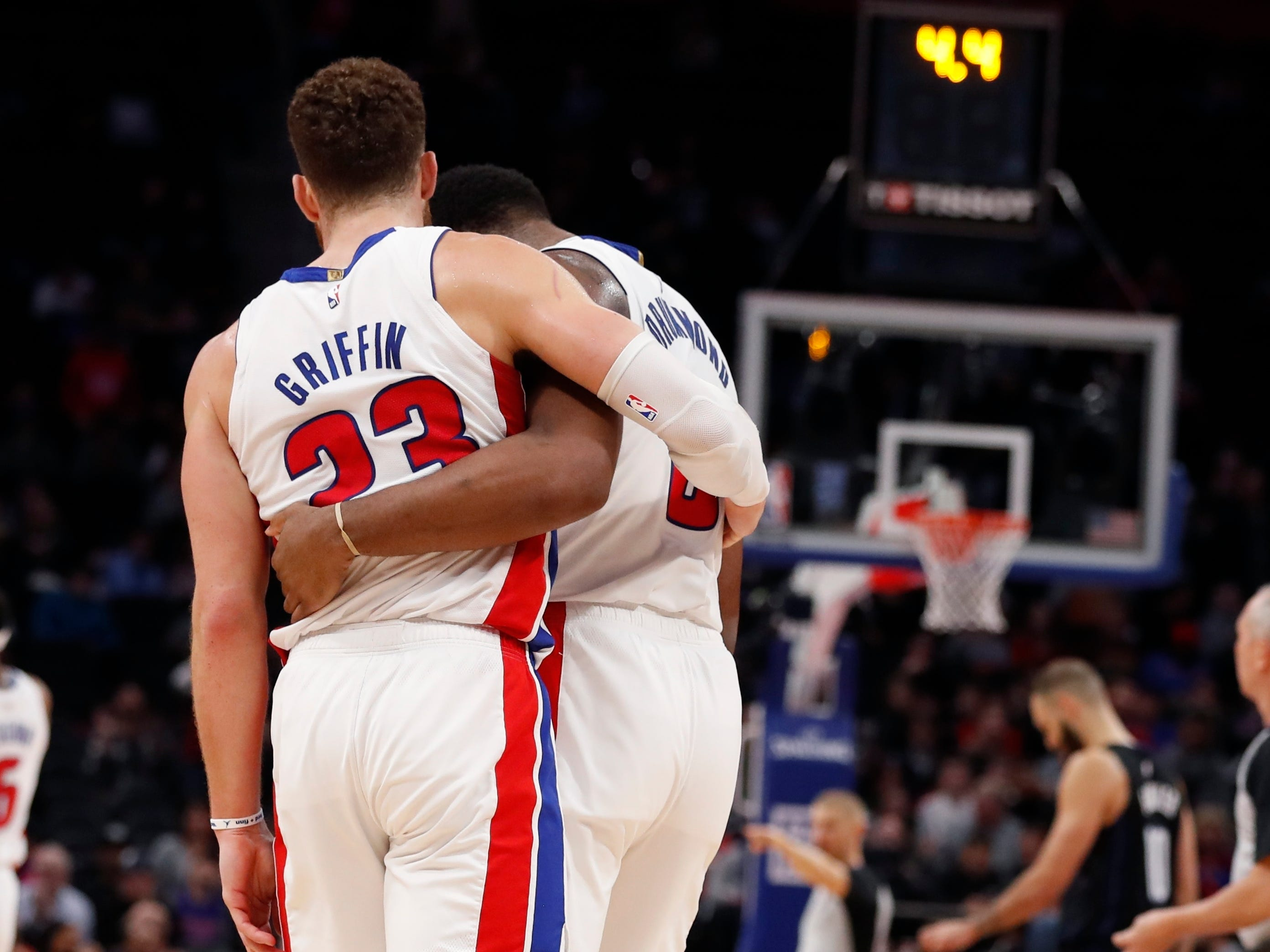 Detroit Pistons forward Blake Griffin (23) hugs center Andre Drummond (0) as the clock winds down in overtime as the Pistons beat the Orlando Magic, 120-115, at Little Caesars Arena in Detroit, Wednesday night, January 16, 2019.