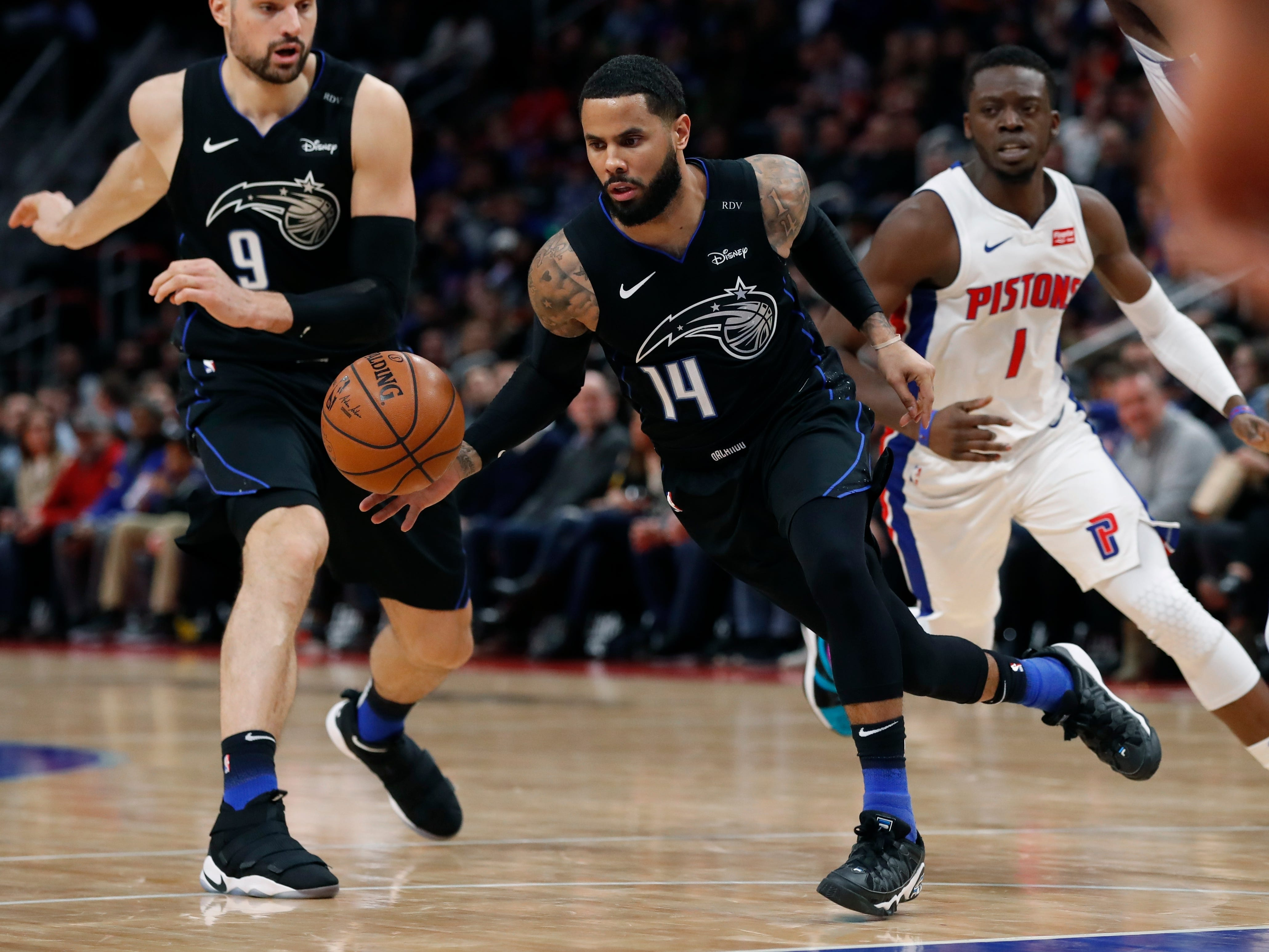 Orlando Magic guard D.J. Augustin (14) controls the ball during the second half.