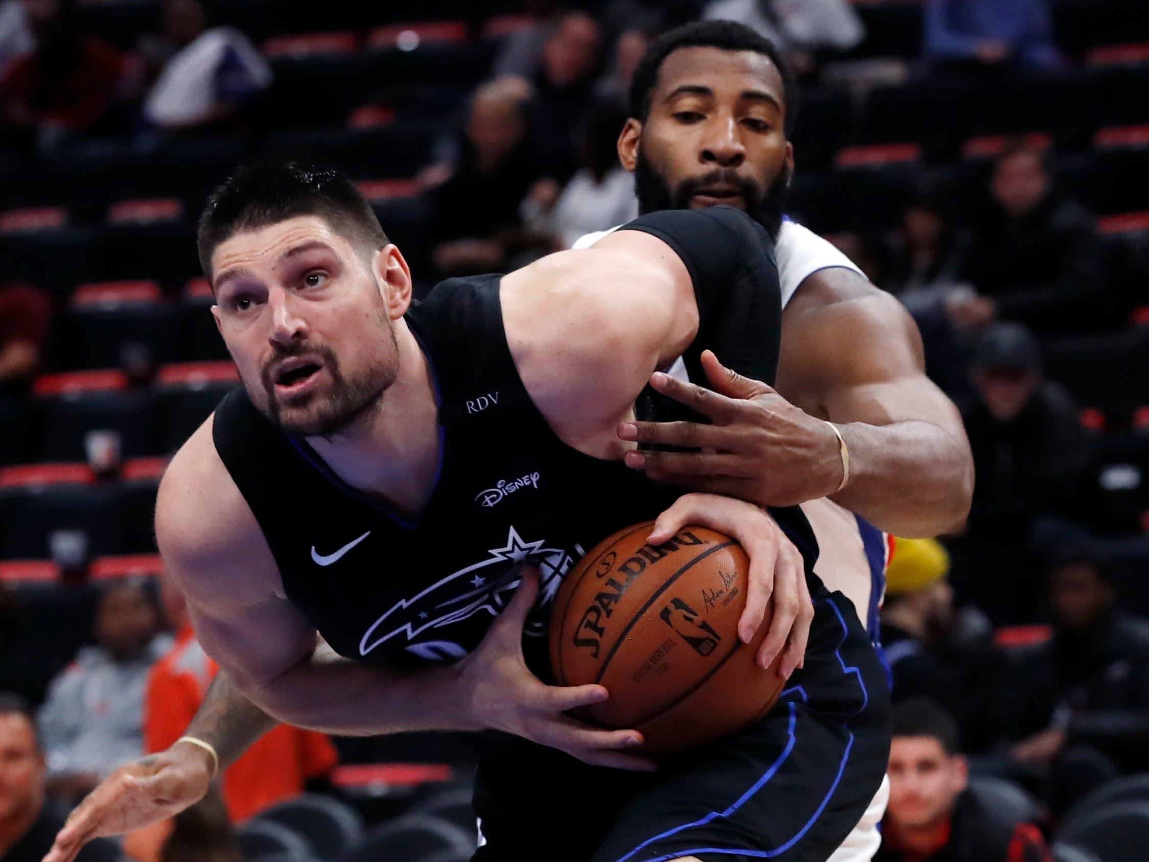 Orlando Magic center Nikola Vucevic (9) is fouled by Detroit Pistons center Andre Drummond during the second half.