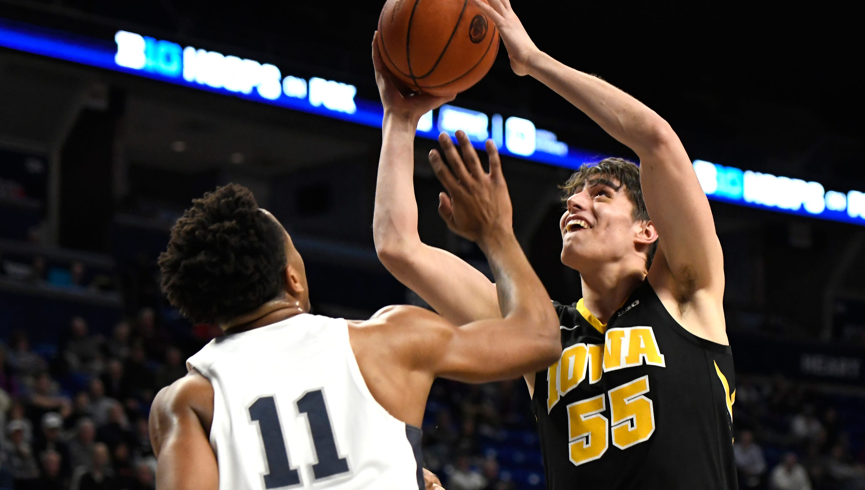 Iowa forward Luka Garza (55) takes a shot over Penn State forward Lamar Stevens (11) during the first half on Wednesday.