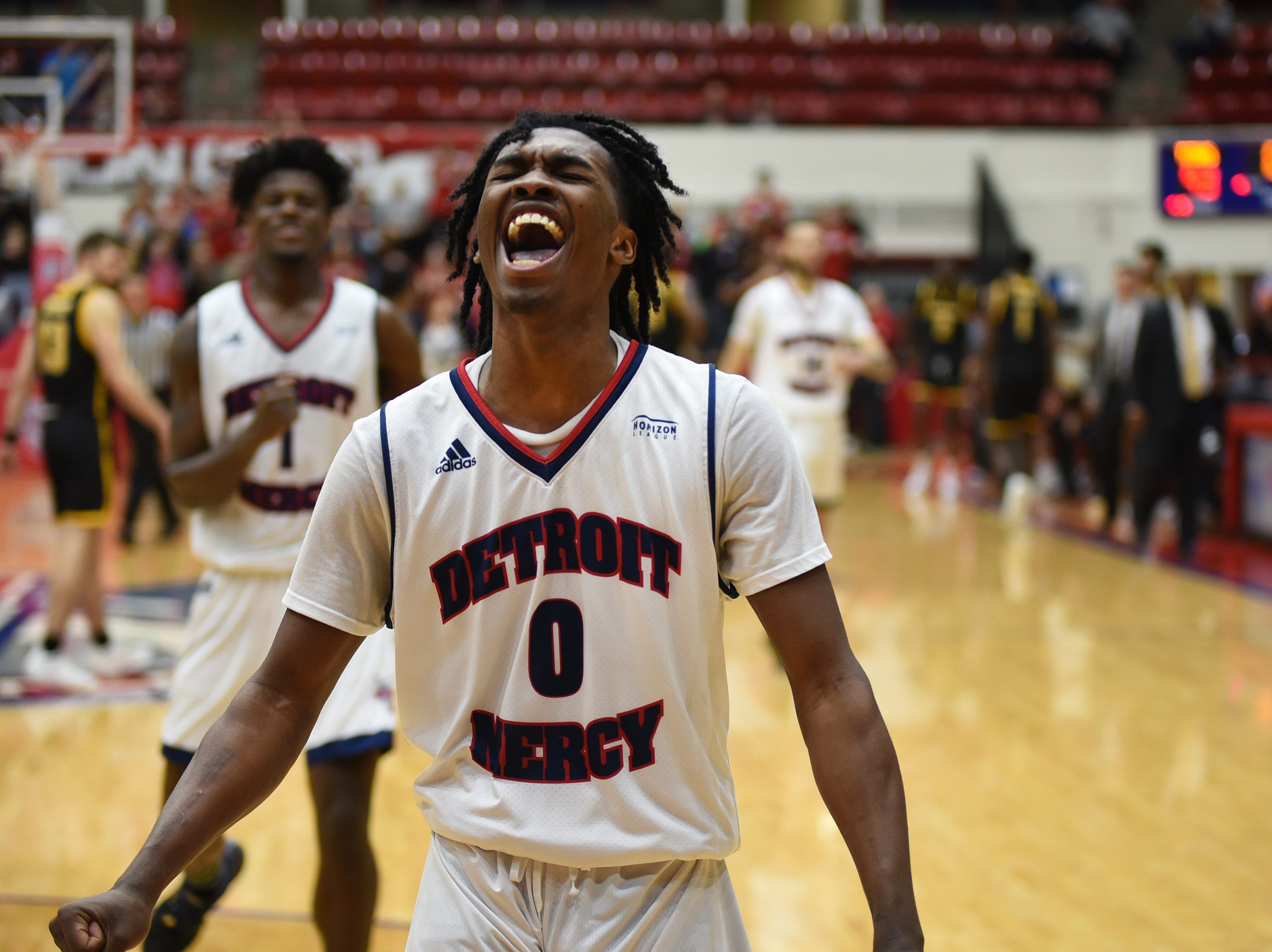 University of Detroit Mercy player Antoine Davis reacts after scoring 32 points to lead the Titans to victory over Milwaukee 93-84 at Calihan Hall in Detroit on Saturday, January 12, 2019. The freshman son of coach Mike Davis is averaging almost 28 points per game.