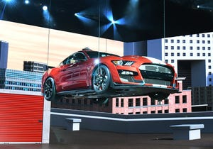 The Ford Shelby Mustang  GT500 is lowered onto the NAIAS stage for its reveal.