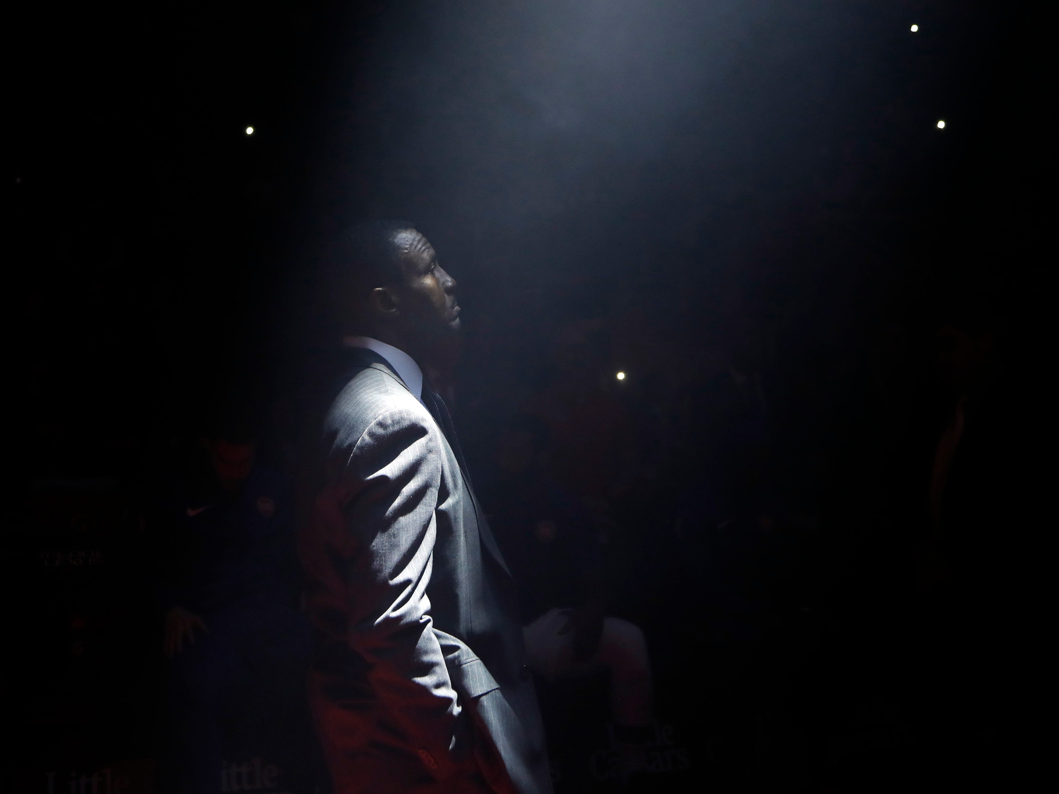 Detroit Pistons head coach Dwane Casey waits during player introductions before the first half.