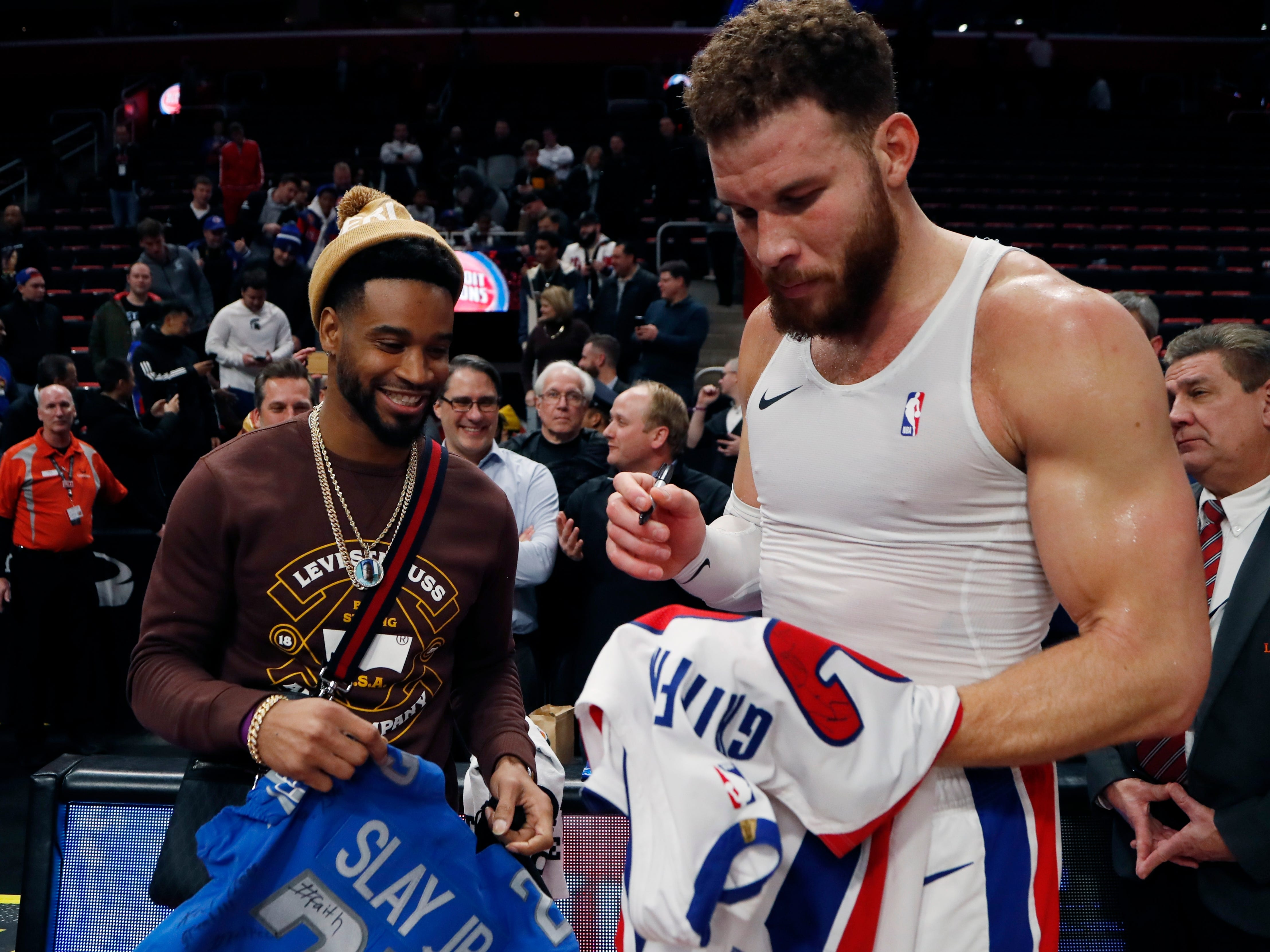 Detroit Lions cornerback Darius Slay exchanges jerseys with Detroit Pistons forward Blake Griffin (23) after the game.