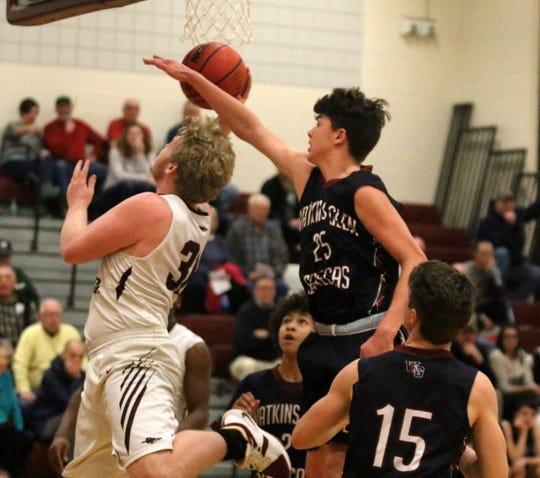 Zach Elliott of Odessa-Montour goes up for a shot as Adam Pastore of Watkins Glen defends during boys basketball Jan. 16, 2019 in Odessa.