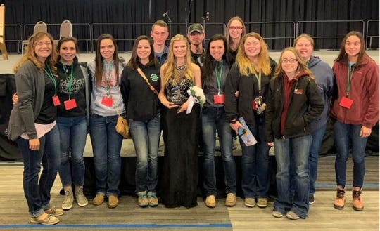 Sandusky County Junior Fair Board members stand with Sandusky County Fair Queen Regan Dreager. The local fair queen participated in the 2019 Ohio Fair Queen contest earlier in January.