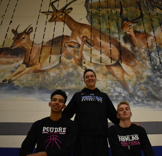 Seniors Damian Forrest, left, and Jack Fisher have helped coach Jeff Brubaker and Poudre basketball rise from difficult times.