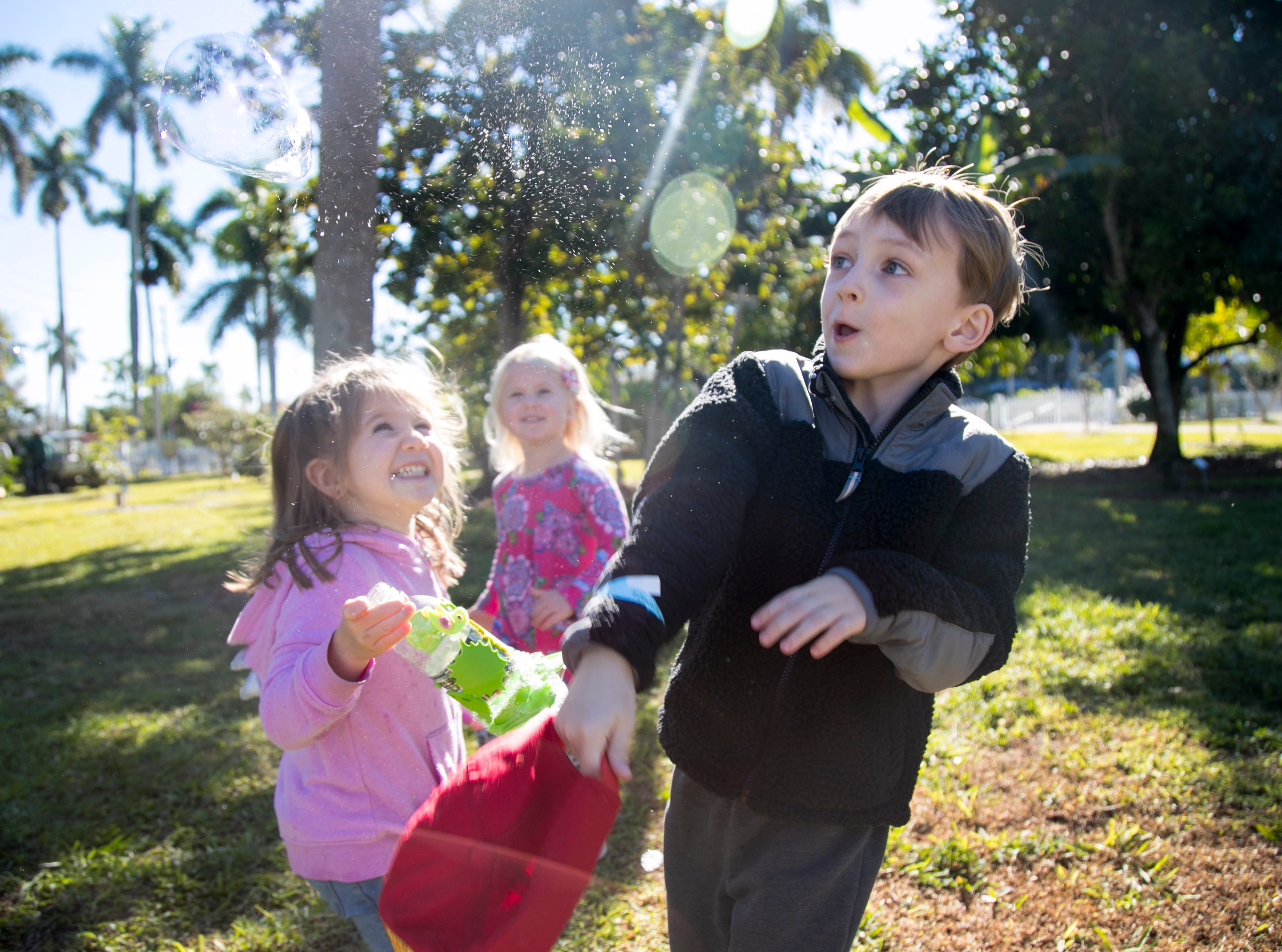 Avery Berry, 3, left, Stella Curry, 3, center, laugh as Mac Halligan, 4, right, pops a giant bubble during the monthly Emerging Inventors program on Thursday, January 17, 2019, at the Edison & Ford Winter Estates in Fort Myers. This month's program was called Bouncing Bubbles. The next program, which is for children 5 and younger, is February 21 at 9:30 am, and is called is LEGO Art and Engineering.