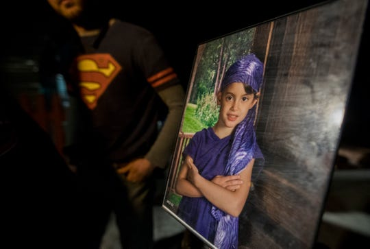 A family picture of a young Alana Marie Tamplin is displayed Wednesday, January 16, 2019 evening during a press interview.