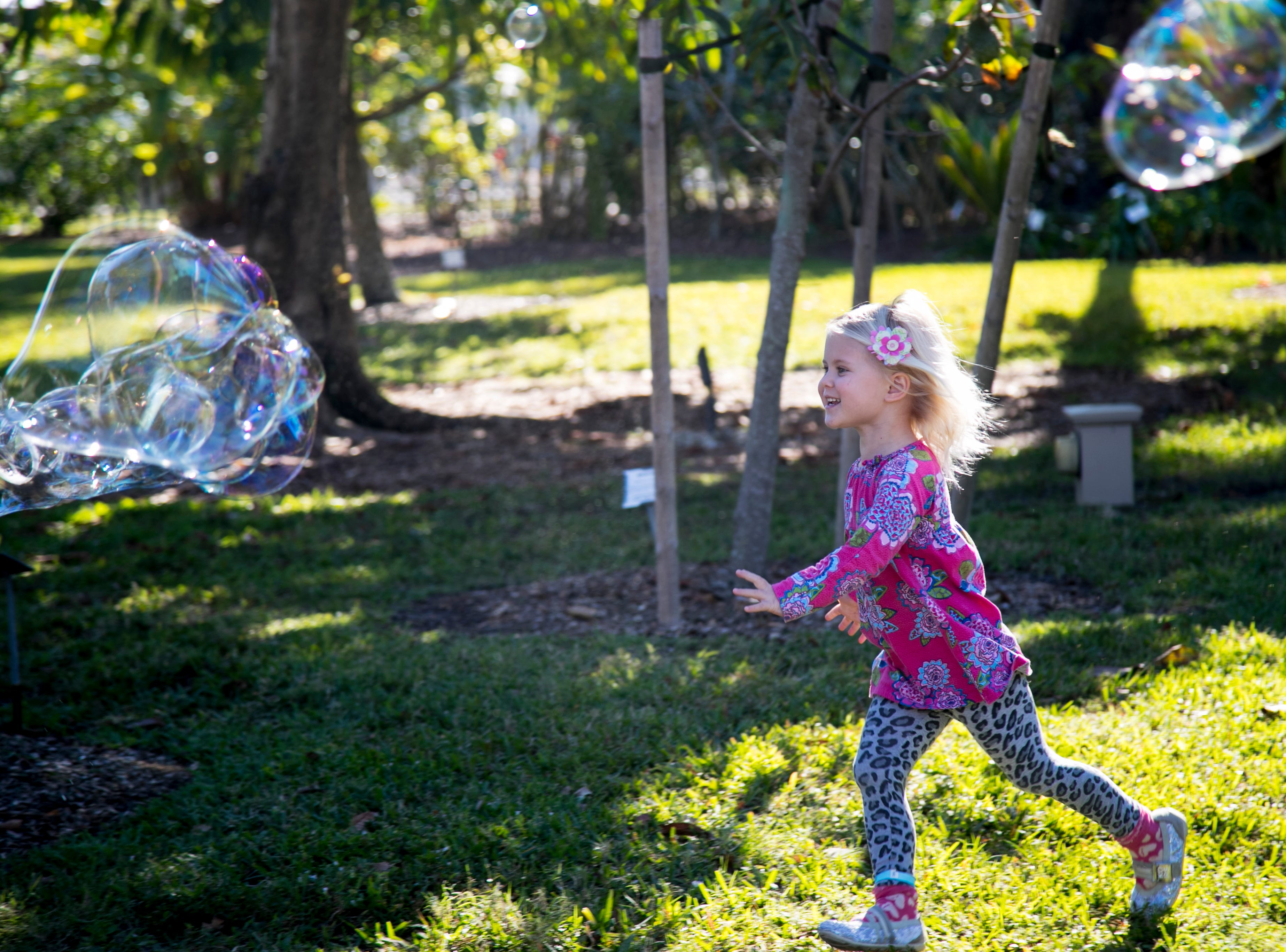 Stella Curry, 3, chases giant bubbles during the monthly Emerging Inventors program on Thursday, January 17, 2019, at the Edison & Ford Winter Estates in Fort Myers. This month's program was called Bouncing Bubbles, and children got to make their own bubble wands.