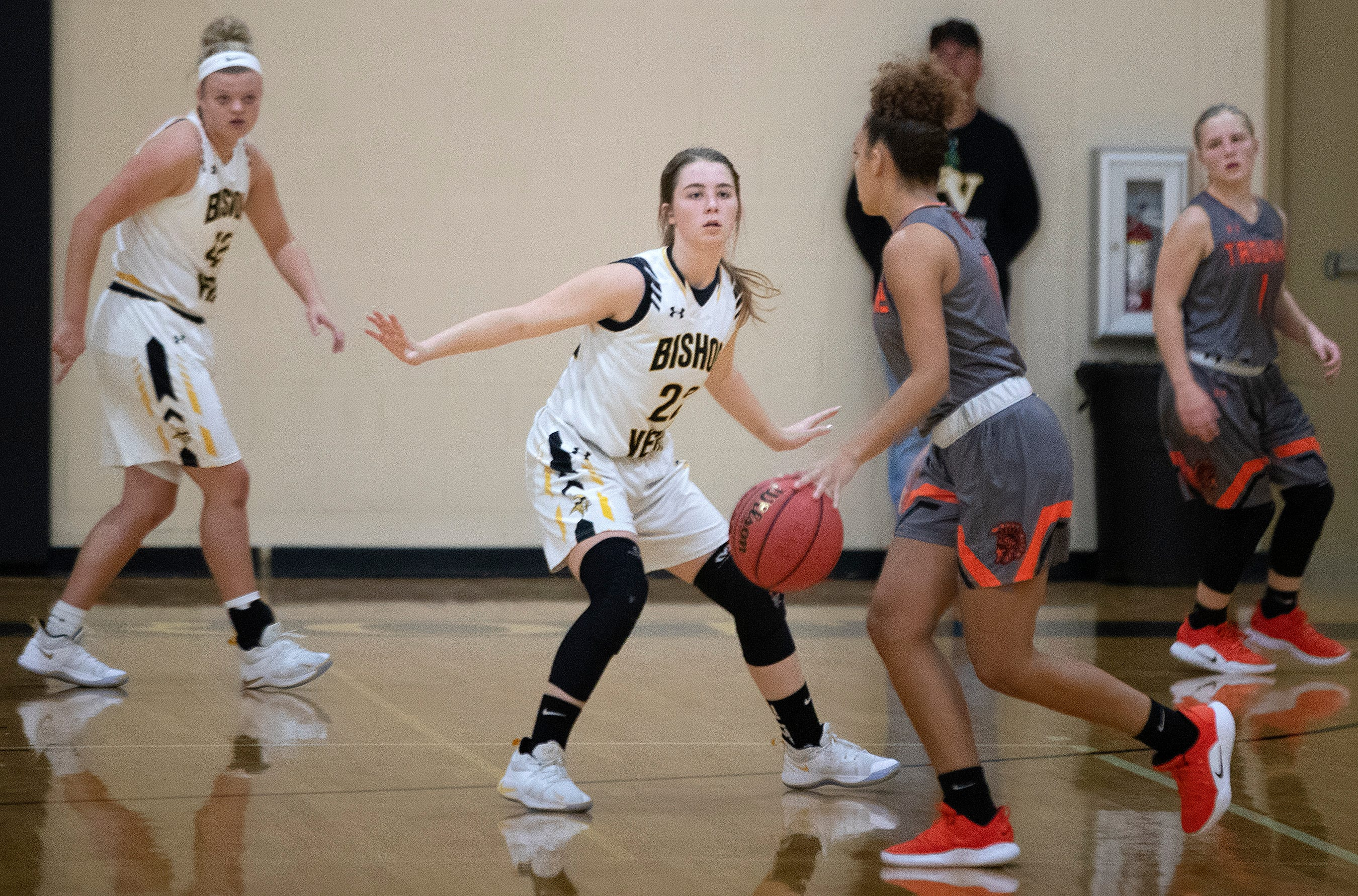 Bishop Verot High School's Claire Woolam defends against Lely on Wednesday at Bishop Verot in Fort Myers.