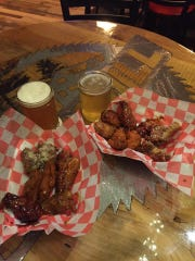 Uncle Rico's serves hot wings every Monday out of the Sawmill Food Trailer next to Sawmill Brewing in Merrill.