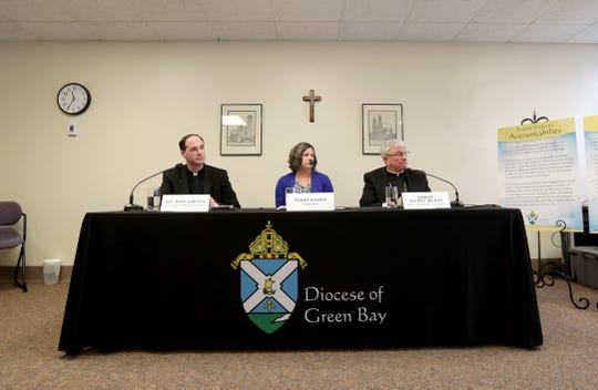 Green Bay Bishop David L. Ricken, right, Chancellor Tammy Basten, center, and Vicar for Canonical Services Rev. John Girott, at a press conference Thursday announcing the release of a list of 46 diocesan priests who were found to have sexually assaulted minors.