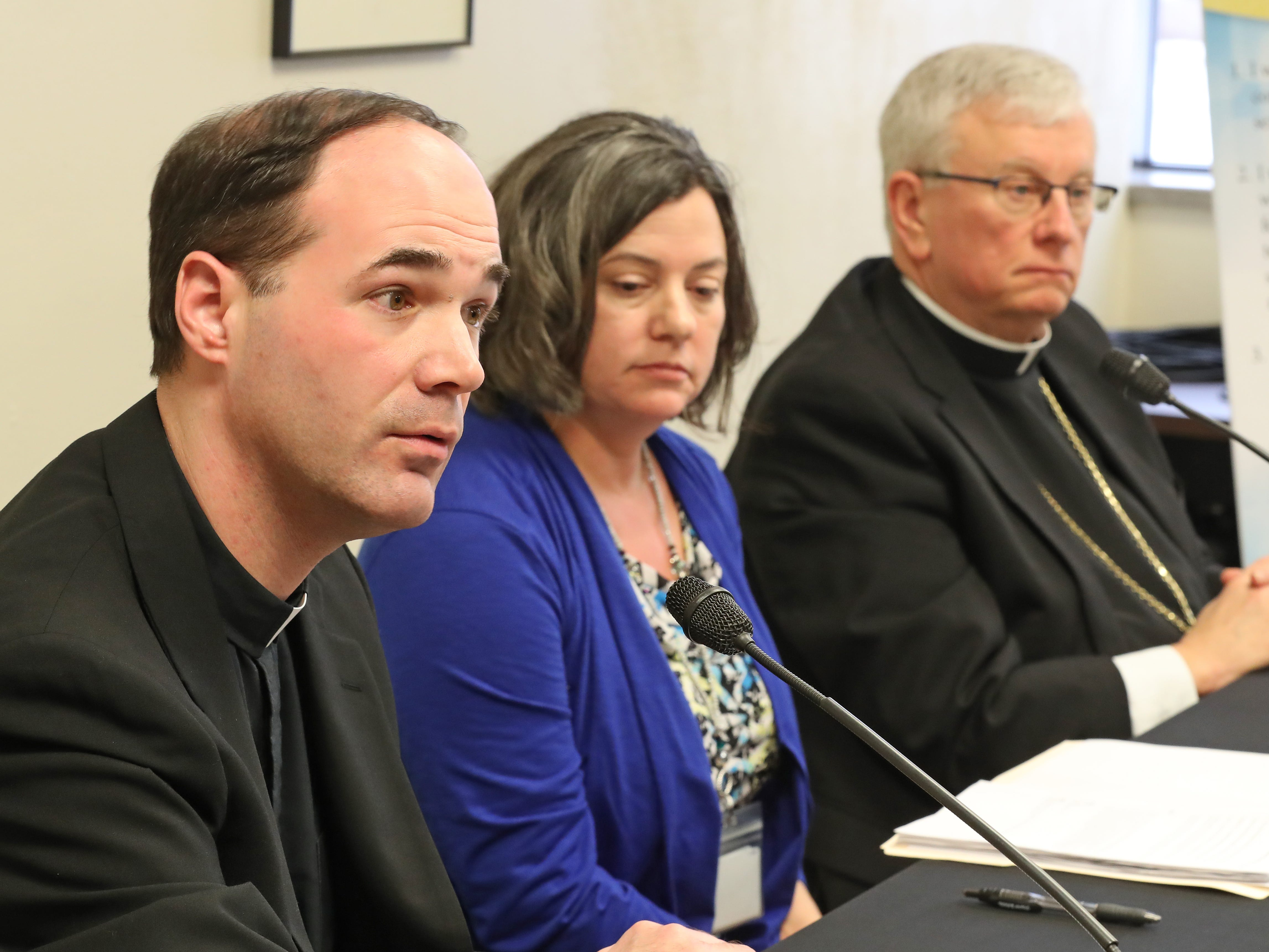 Rev. John Girotti, vicar for Canonical Services for the Catholic Diocese of Green Bay, discusses the release of the names on Thursday of 46 priests confirmed to hve abused minors at the Diocese of Green Bay offices in Allouez. At right are Bishop David L.Ricken and diocese Chancellor Tammy Basten.