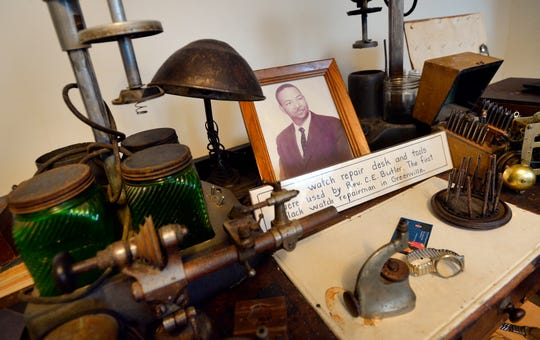 The desk of Rev. C.E. Butler, father of Ruth Ann Butler, director of the Greenville Cultural Exchange Center, sits inside the Greenville Cultural Exchange Center on Friday, Jan. 2, 2015. Rev. Butler was the first black watch repairman in Greenville.
