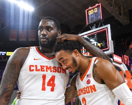 Clemson forward Elijah Thomas (14) and guard Marcquise Reed (2) celebrate a 72-60 win over Georgia Tech at Littlejohn Coliseum in Clemson Wednesday, January 16, 2019.