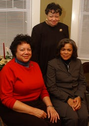 From left to right: Louella Butler, Ruth Ann Butler and Yolande Allen enjoy the holiday open house at the Black History Museum in Greenville on Dec. 14, 2003.