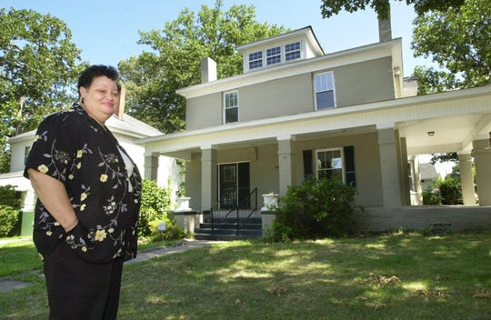 Ruth Ann Butler, director of the Greenville Cultural Exchange Center, stands in front of the newly remolded center on Arlington Road in downtown Greenville, Friday, July 19, 2002.
