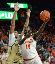 Clemson forward Elijah Thomas (14) shoots near Georgia Tech guard Michael Devoe(0) during the second half at Littlejohn Coliseum in Clemson Wednesday, January 16, 2019.