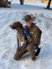 UPS driver Ryan Arens rescued Sadie, a wirehaired pointing griffon who was struggling in an icy pond.