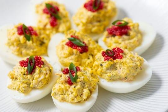 Lobster deviled eggs get a nice little kick with some bubbly.