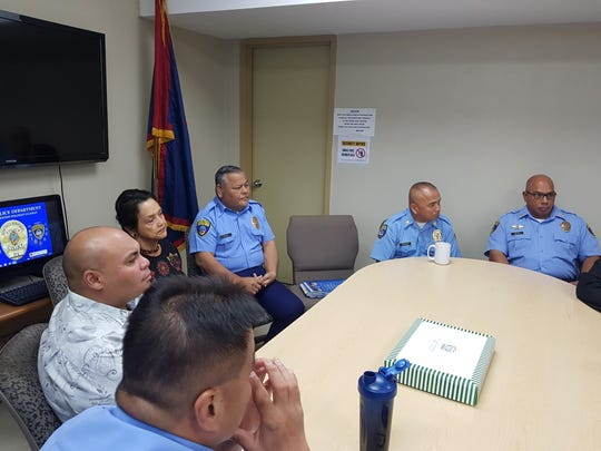 Gov. Lou Leon Guerrero and Lt. Gov. Josh Tenorio listen to Guam Police Department leaders during a visit at the GPD headquarters in Tiyan on Jan. 17, 2019.