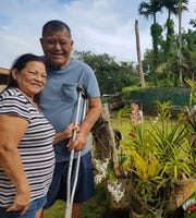 Margaret Blas, 68, and Pedro Blas Sr., 75, pause for a photo outside their Macheche home in 2019. Husband Pedro Blas Sr. sold tuba from 1992 to 2007, the year the coconut rhinoceros beetle was first spotted on Guam. A leafless coconut tree can be seen to his right.