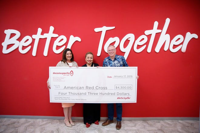 Docomo Pacific contributed $8 million worth of free services and donations to Super Typhoon Yutu relief efforts in the CNMI. Docomo customers participated in the company's Text-To-Donate Campaign, raising a total of $4,300 for the American Red Cross. Pictured from left are Elizabeth Henry, Vice President of Customer Care and Retail, DOCOMO PACIFIC; Chita Blaise, Executive Director, American Red Cross Guam Chapter; and Roderick Boss, President and CEO.