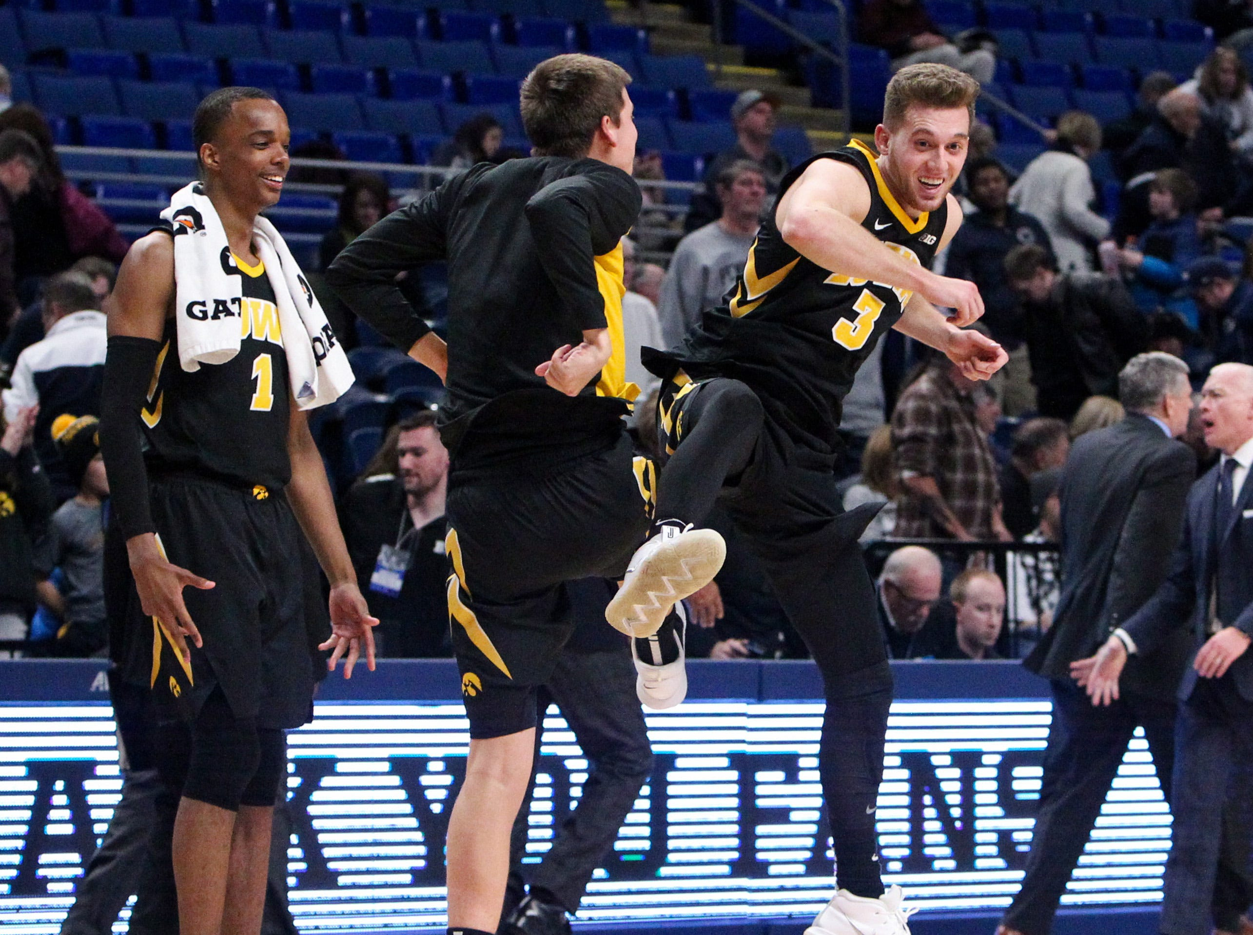 Jan 16, 2019; University Park, PA, USA; Iowa Hawkeyes guard Jordan Bohannon (3) celebrates with Austin Ash following the game against the Penn State Nittany Lions at Bryce Jordan Center. Iowa defeated Penn State 89-82. Mandatory Credit: Matthew O'Haren-USA TODAY Sports
