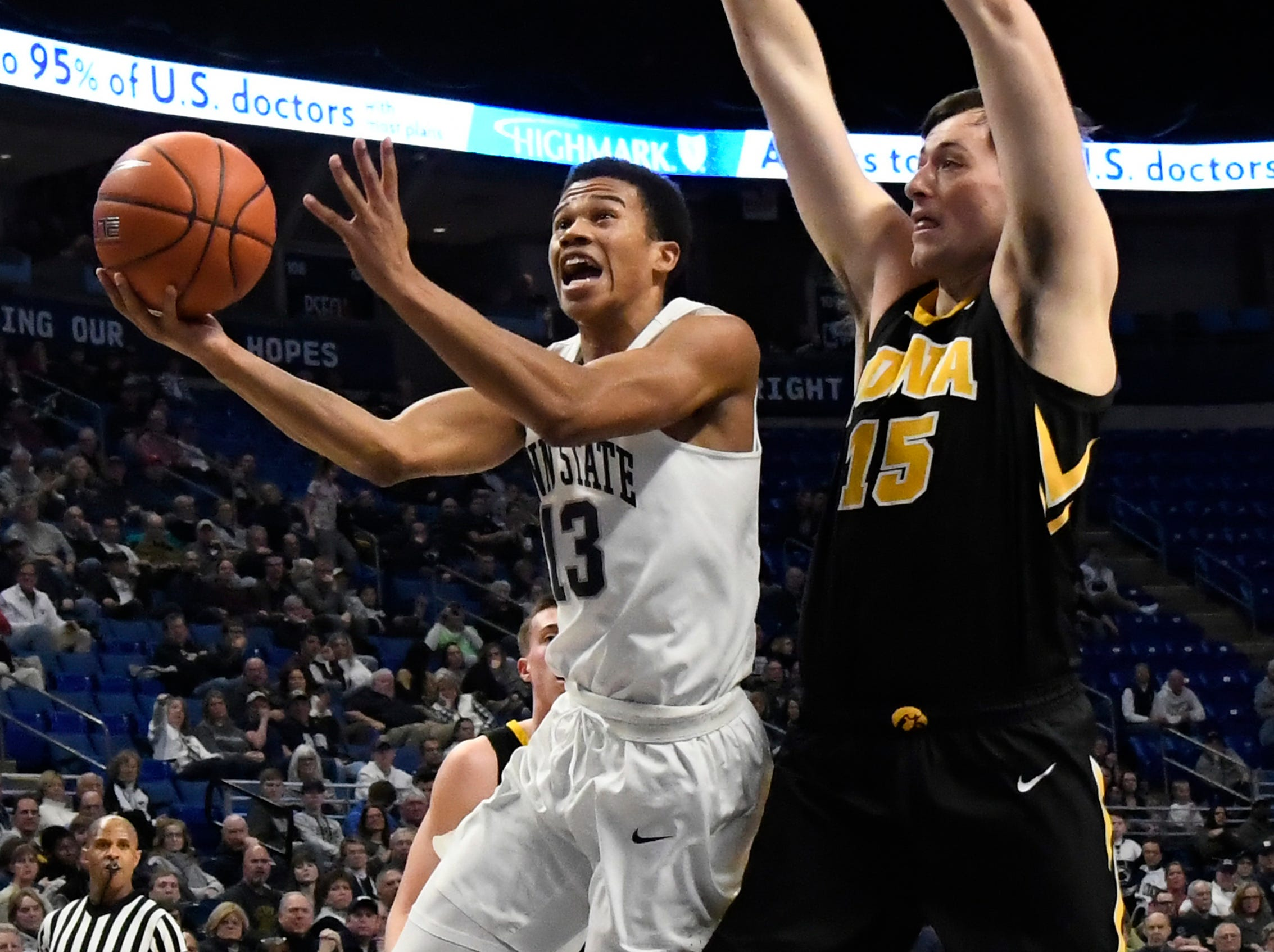 Penn State guard Rasir Bolton (13) shoots past Iowa forward Ryan Kriener (15) during the first half of an NCAA college basketball game Wednesday, Jan. 16, 2019, in State College, Pa.