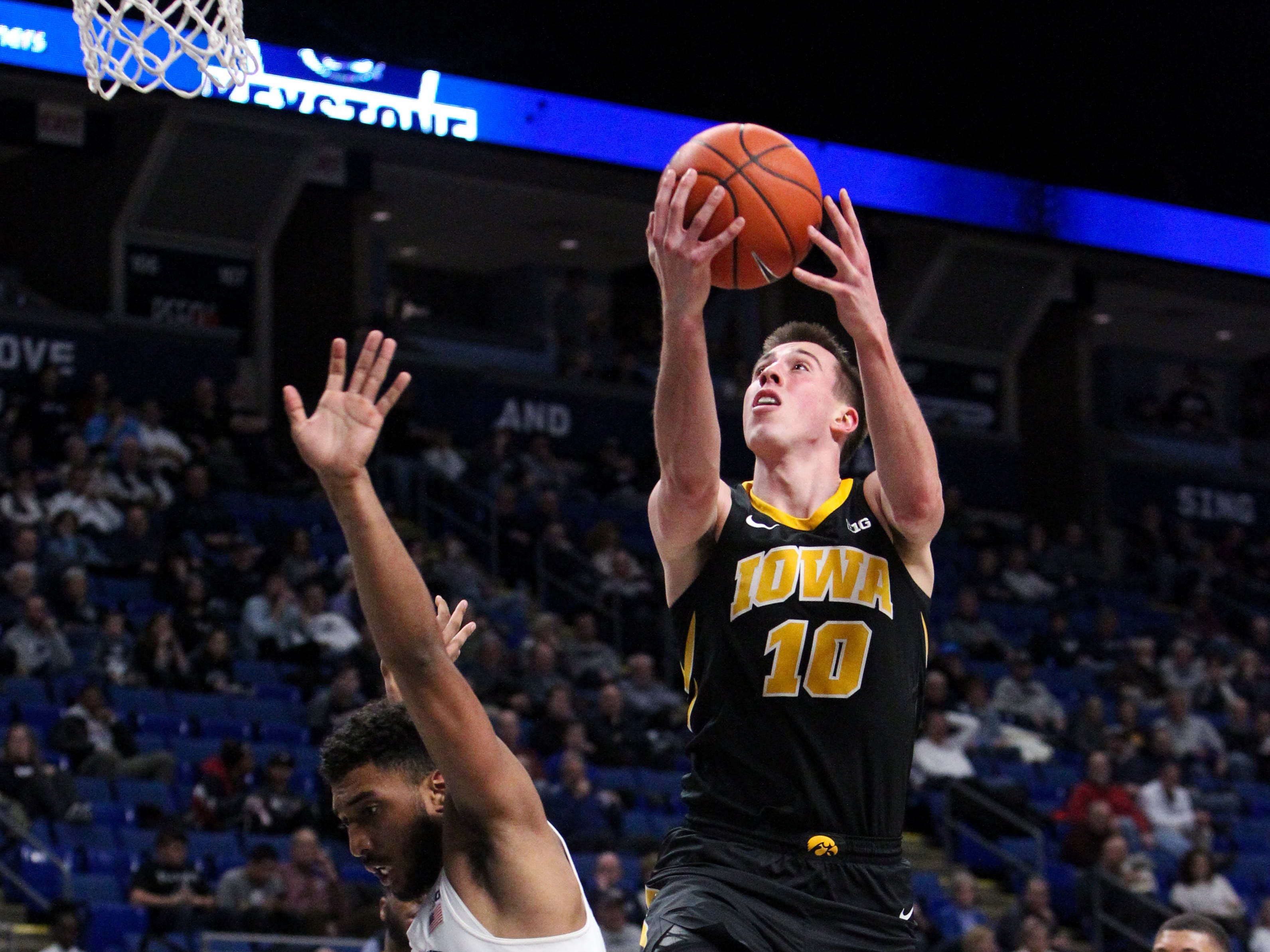 Jan 16, 2019; University Park, PA, USA; Iowa Hawkeyes guard Joe Wieskamp (10) drives to the basket as Penn State Nittany Lions guard Josh Reaves (23) defends during the second half at Bryce Jordan Center. Iowa defeated Penn State 89-82. Mandatory Credit: Matthew O'Haren-USA TODAY Sports