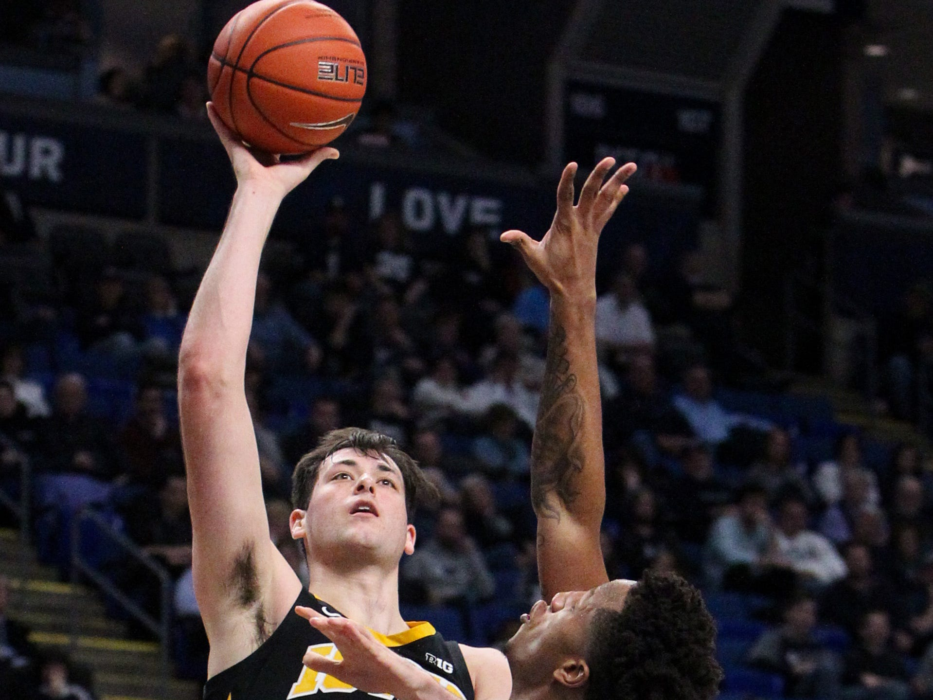 Jan 16, 2019; University Park, PA, USA; Iowa Hawkeyes forward Ryan Kriener (15) shoots the ball as Penn State Nittany Lions forward Lamar Stevens (11) defends during the second half at Bryce Jordan Center. Mandatory Credit: Matthew O'Haren-USA TODAY Sports