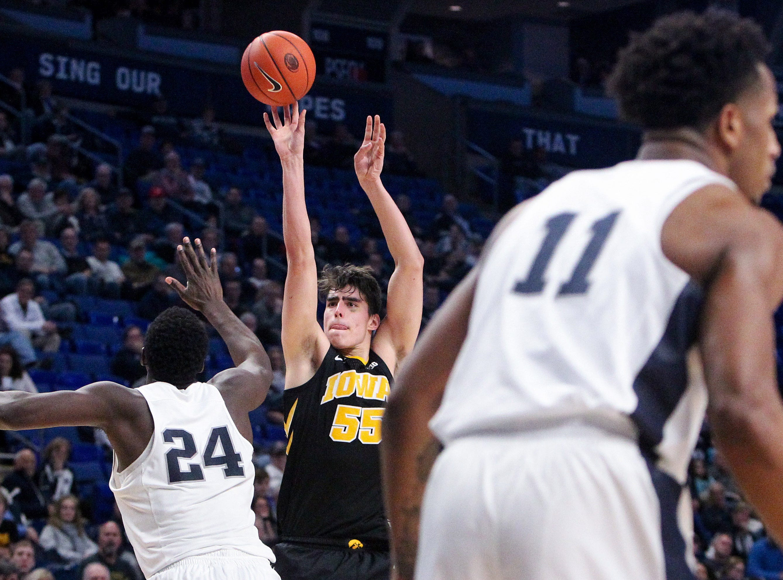 Jan 16, 2019; University Park, PA, USA; Iowa Hawkeyes forward Luka Garza (55) shoots the ball as Penn State Nittany Lions forward Mike Watkins (24) defends during the second half at Bryce Jordan Center. Mandatory Credit: Matthew O'Haren-USA TODAY Sports