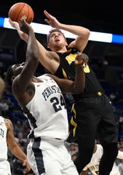 Jordan Bohannon scored 15 of his 19 points from 3-point range in Iowa's 89-82 win at Penn State.