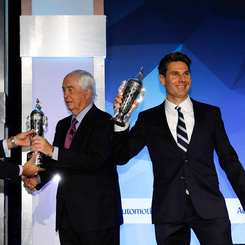 Roger Penske and Will Power are presented with...