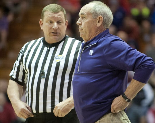 Bloomington South Panthers head basketball coach J.R. Holmes listens to a ref's explanation of a call in the 2016   Seymour Regional.