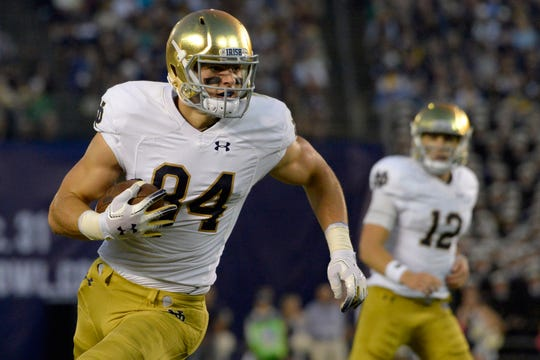 Notre Dame Fighting Irish tight end Cole Kmet (84) runs after a catch during the second quarter against the Navy Midshipmen at SDCCU Stadium.