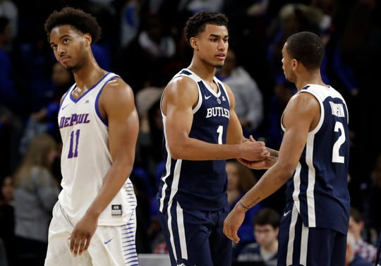 Butler forward Jordan Tucker (1) celebrates with guard Aaron Thompson, right, as DePaul guard Eli Cain walks past after Butler defeated DePaul 87-69 in an NCAA college basketball game Wednesday, Jan. 16, 2019, in Chicago.