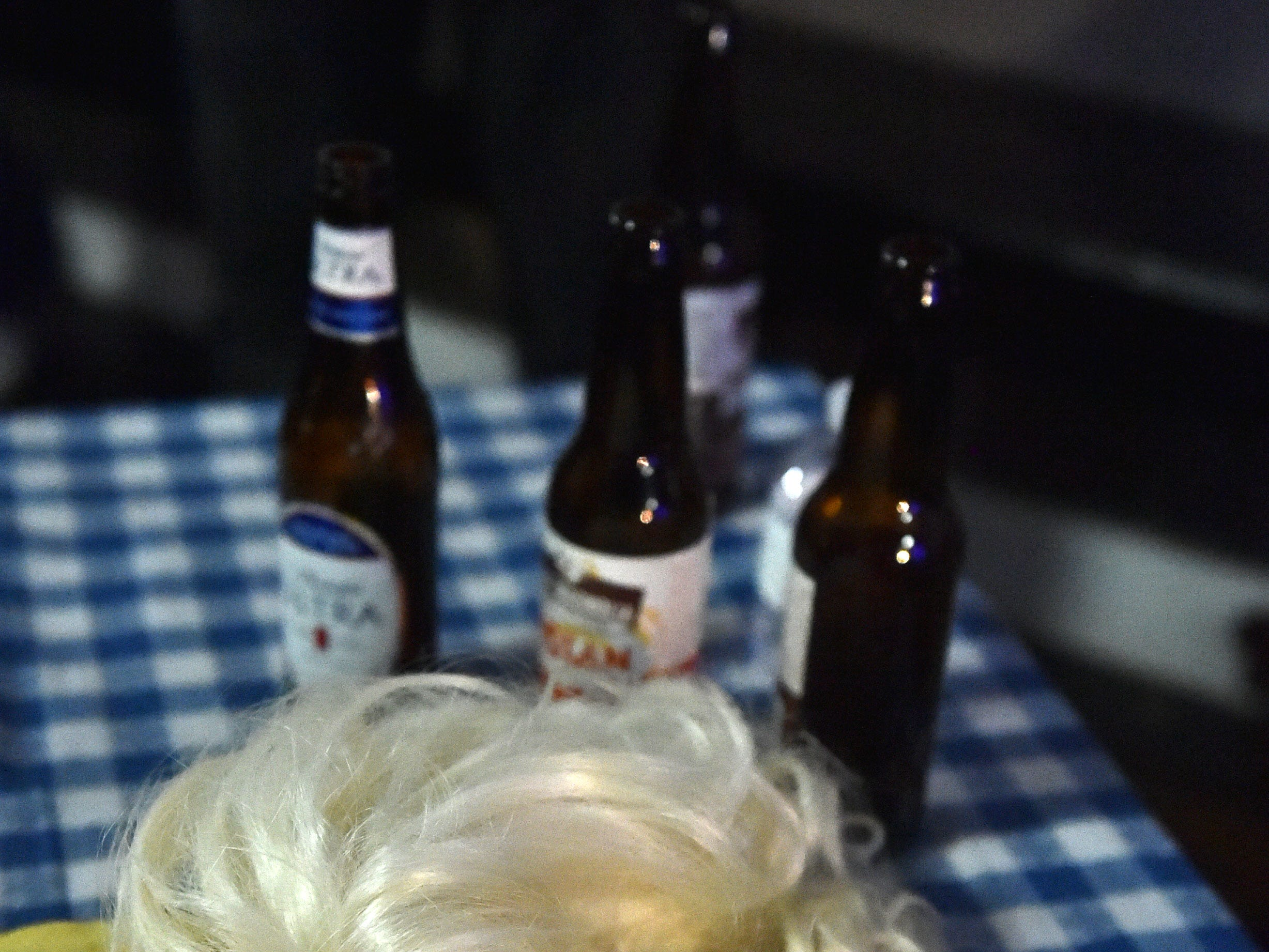 A contestant's wig sit discarded on a table at 4th annual Dolly Should afterparty held at 100 Men Hall in Bay St. Louis. Saturday, Jan. 12, 2019.