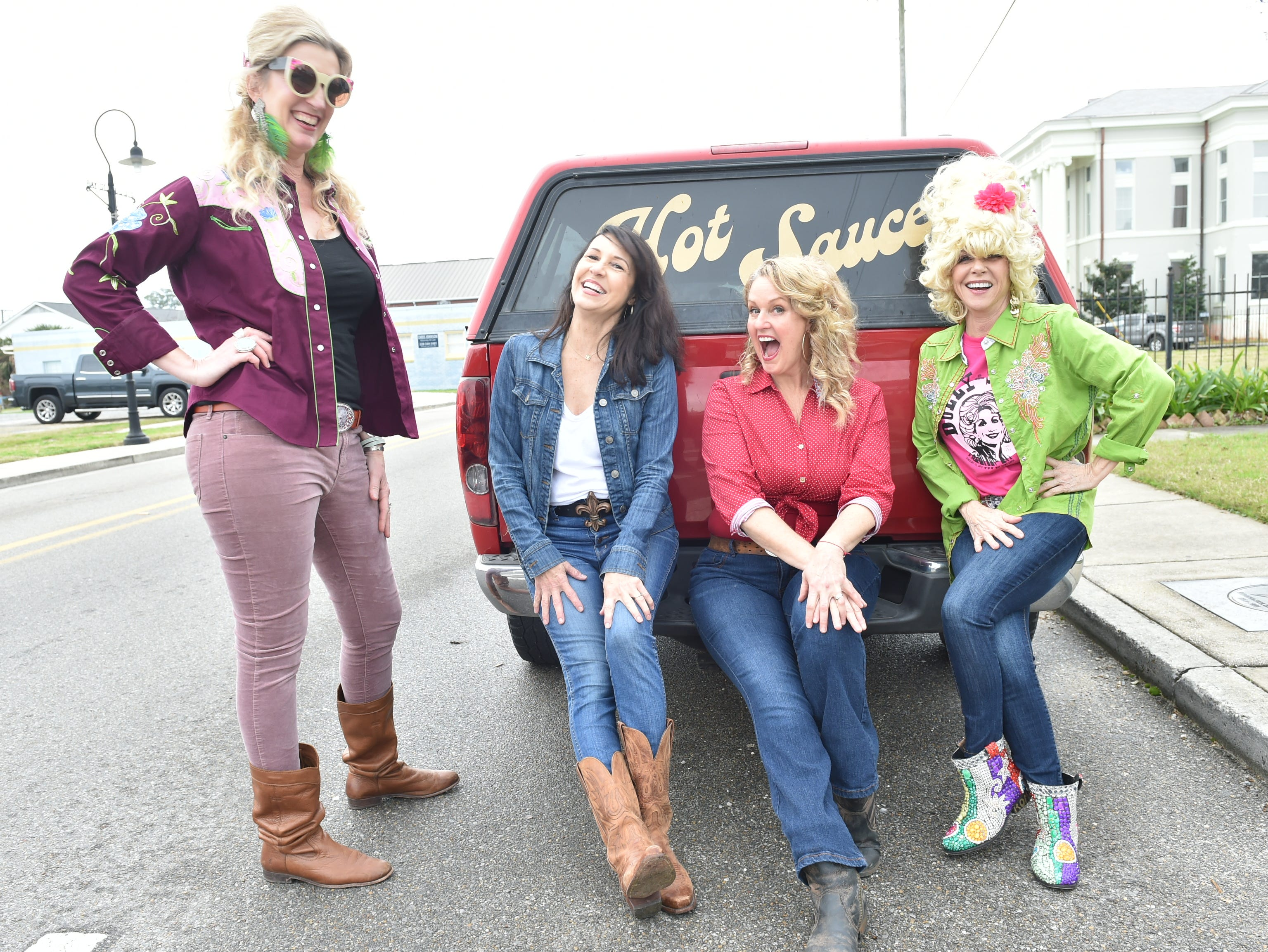 Left to right, Ann Madden, Connie Bourgeois, Alicein Schwabacher and Sandy Maggio hangout on the bumper of a truck during the 4th annual Dolly Should festival-a Dolly Parton-themed event. The hope is Parton will come visit Bay St. Louis. Saturday, Jan. 12, 2019.