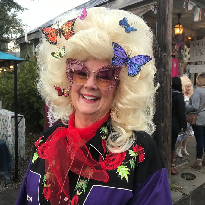Martha Asbury Wilson of Bay St. Louis is all smiles and butterflies as a contestant in the 4th annual Dolly Should festival in Bay St. Louis. The festival pays tribute to the iconic singer and actress and her birthday in hopes Parton will visit the town. Saturday, Jan. 12, 2019.