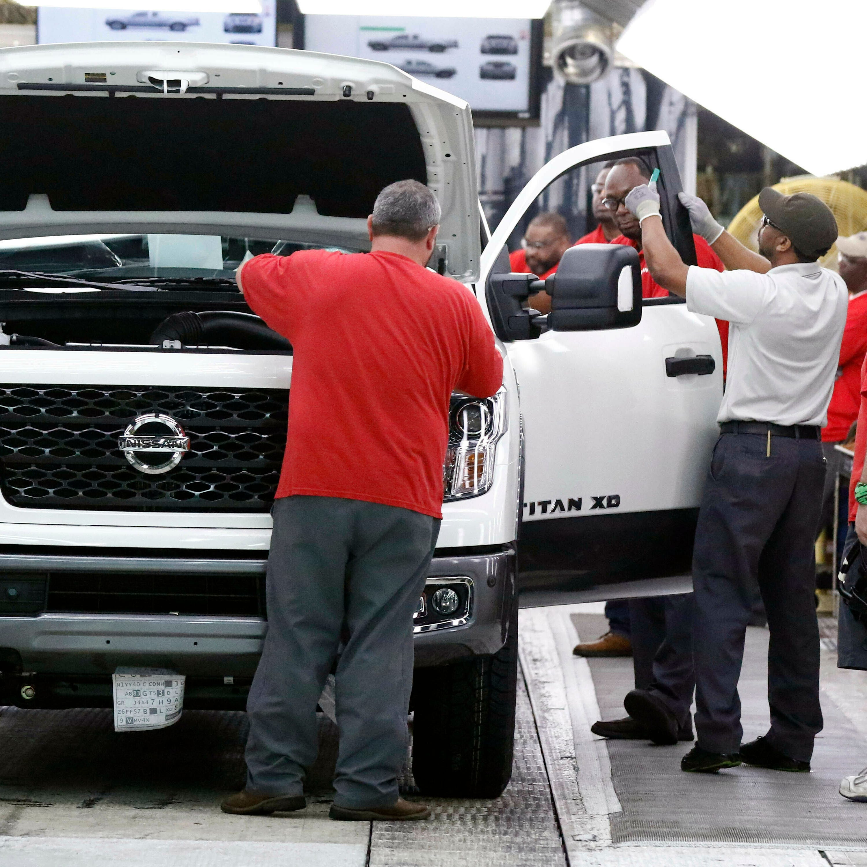 In this 2018 photo technicians make final inspections to vehicles on the assembly line at the Nissan Canton Assembly Plant, in Canton, Miss.
