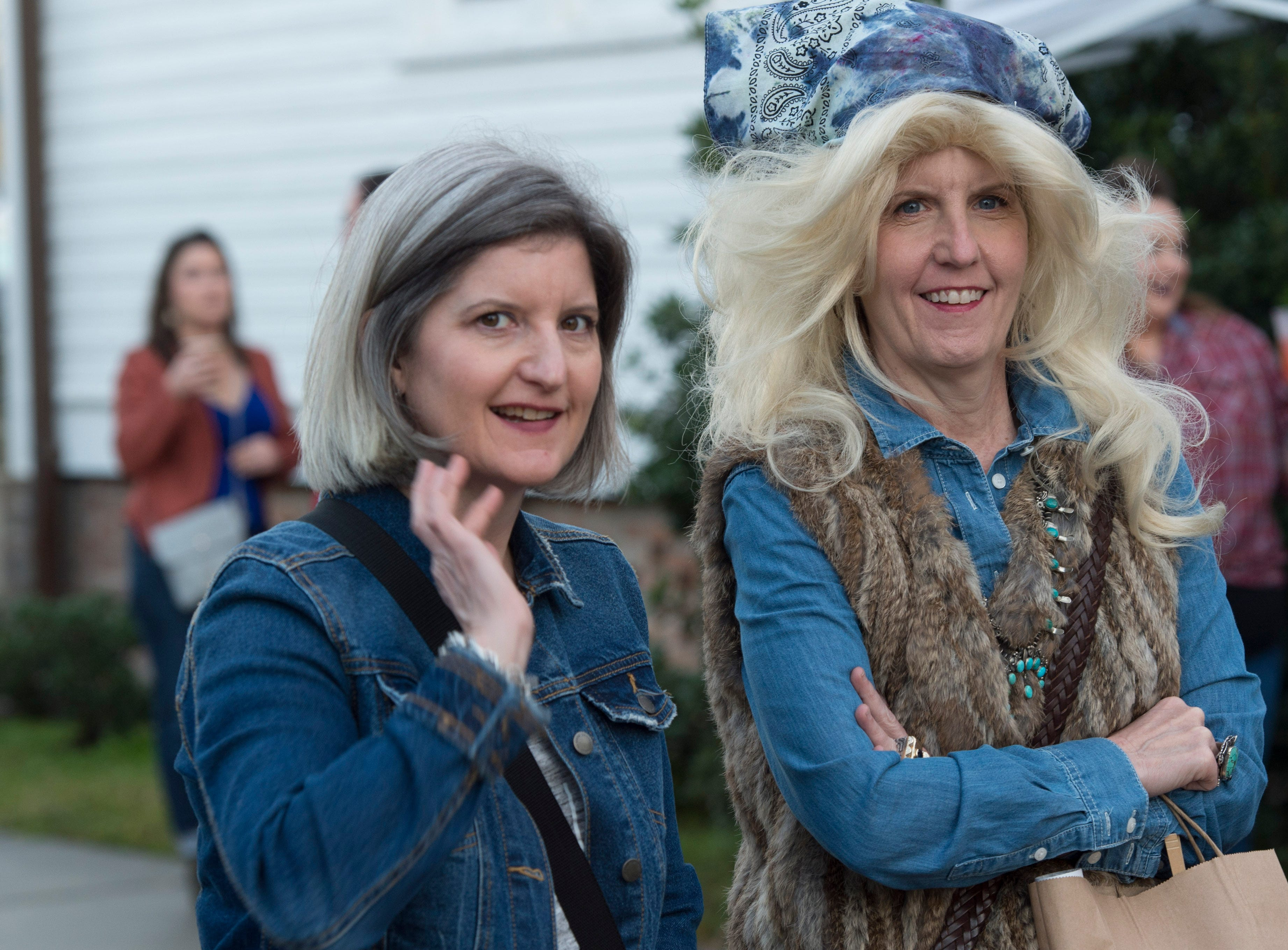 Attendees and fans of the 4th annual Dolly Should festival pose together before the Dolly Parton look-a-like contest held on the porch of the Mockingbird Cafe. Saturday, Jan. 12, 2019.