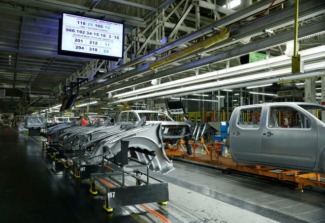 This 2018 photo  shows truck chassis rolling down an assembly line at Nissan's Canton, Miss., assembly plant.