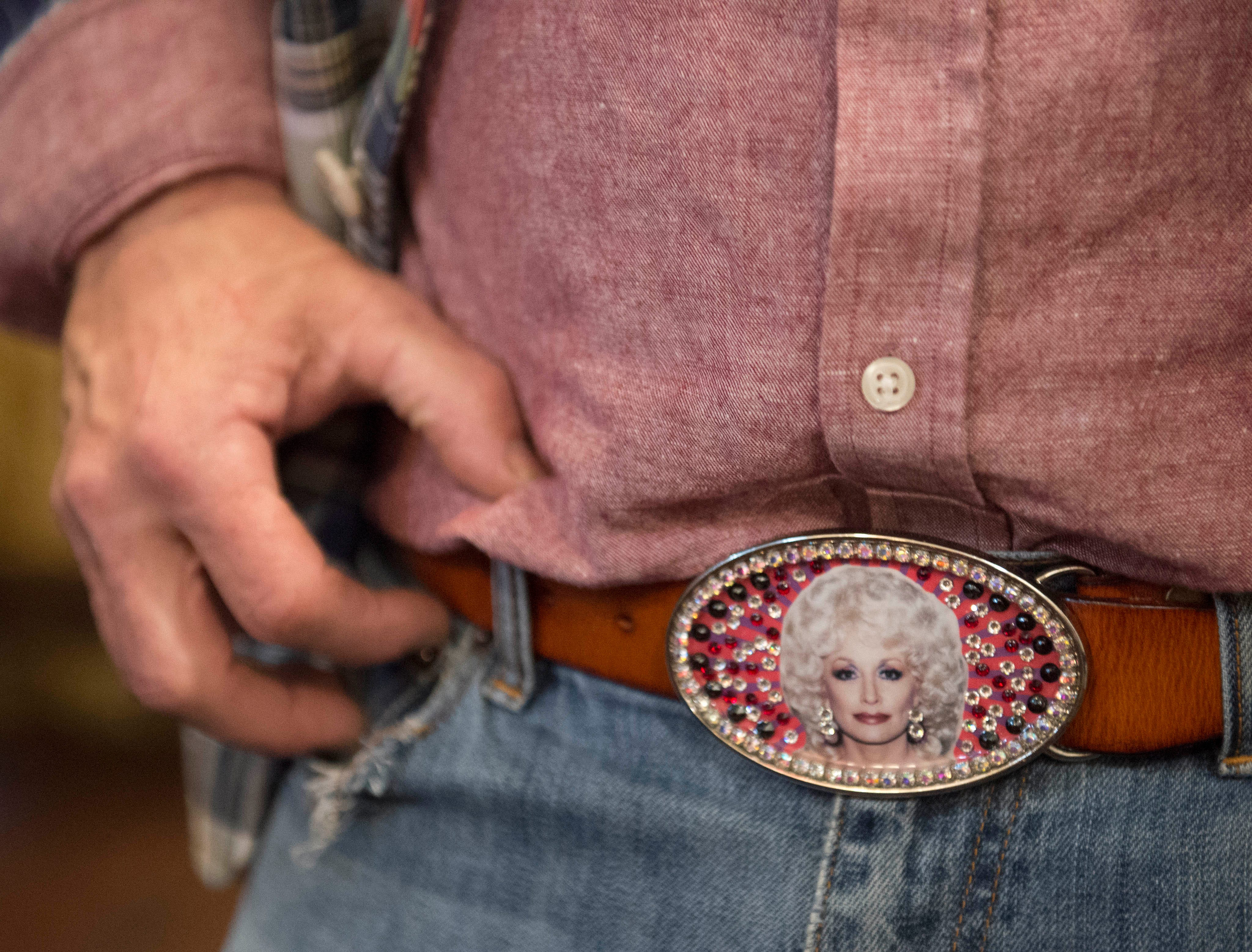 Woodworker Ed Madden of Bay St. Louis dons a belt buckle emblazoned with the image of Dolly Parton. The birthday of the famous songstress and actress is celebrated at the annual Dolly Should event in Bay St. Louis with the hopes Parton will visit the town. Saturday, Jan. 12, 2019.