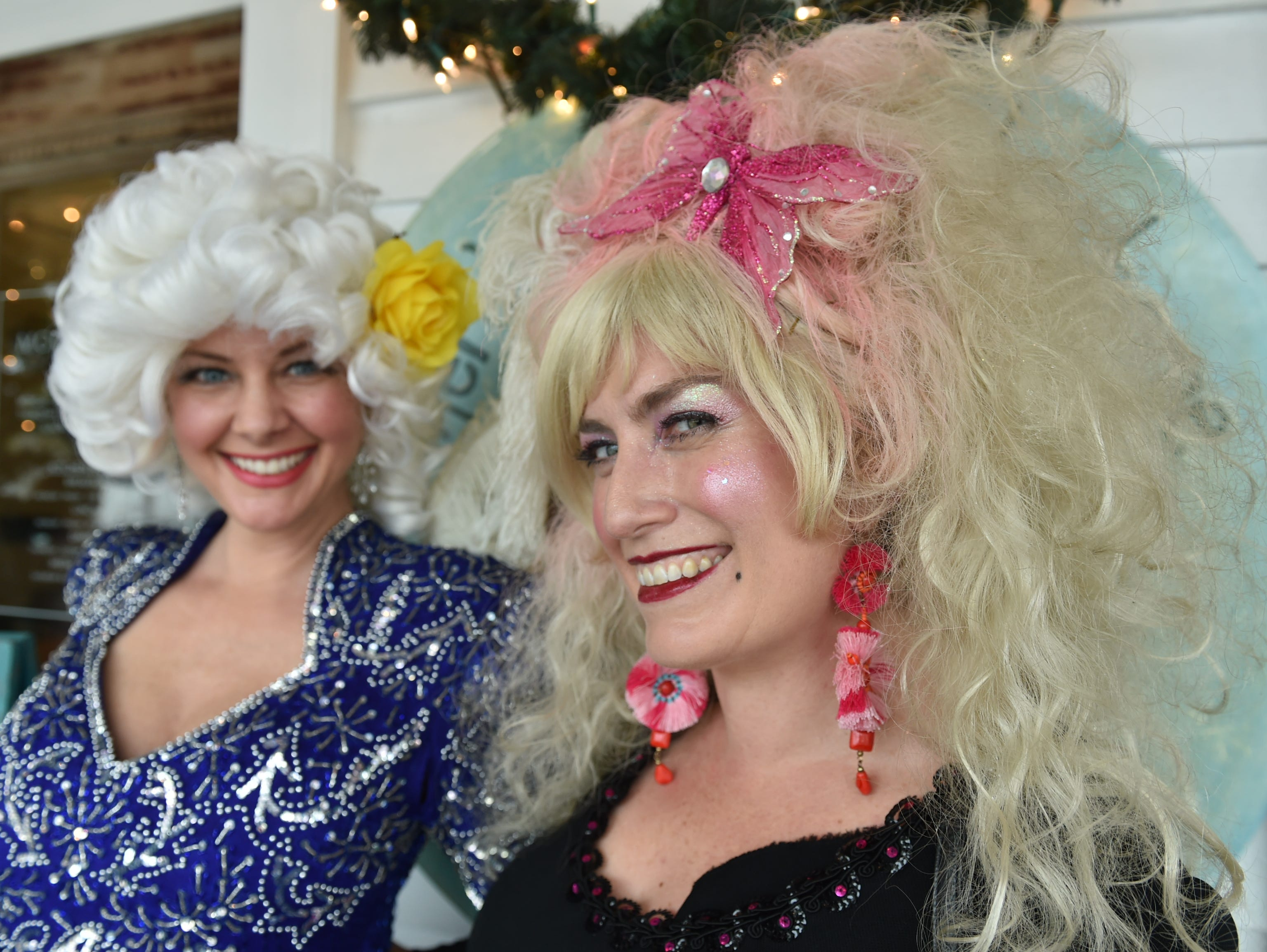 Dolly Parton fans Tiffany Martinez (left) and Amy Robertson (right), both from New Orleans, pose on the porch of the Mockingbird Cafe in Bay St. Louis before the 4th annual Dolly Should festival look-a-like contest. Martinez and Robertson have attended every Dolly Festival to-date. Saturday, Jan. 12, 2019.