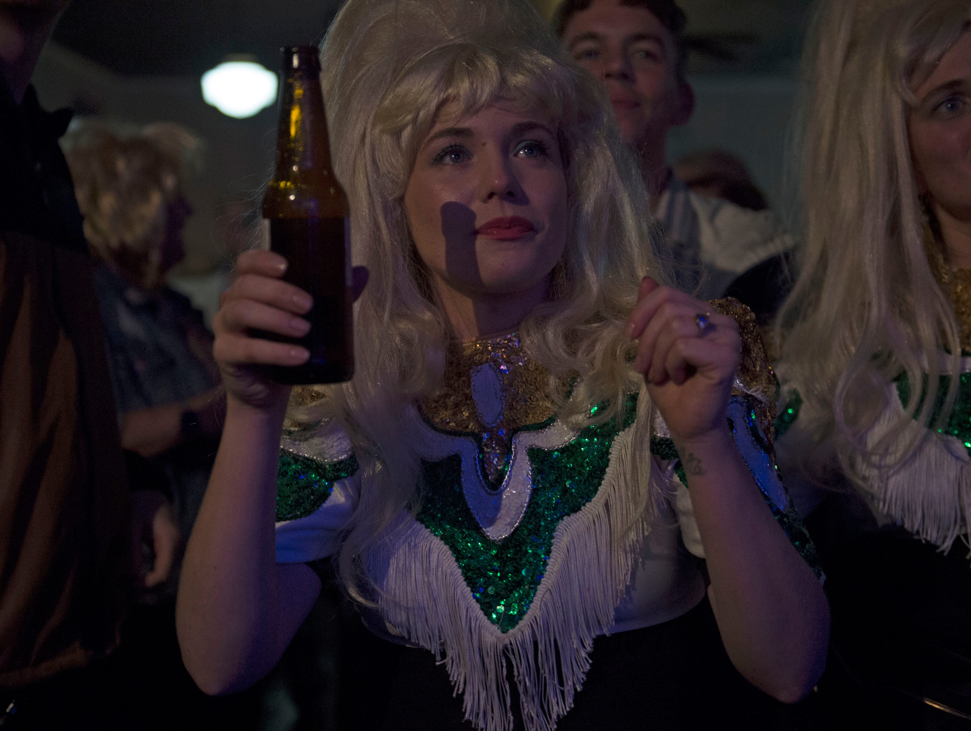 During the after party for the Dolly Should festival a fan of Dolly Parton watches karaoke at 100 Men Hall in Bay St. Louis. Saturday, Jan. 12, 2019.