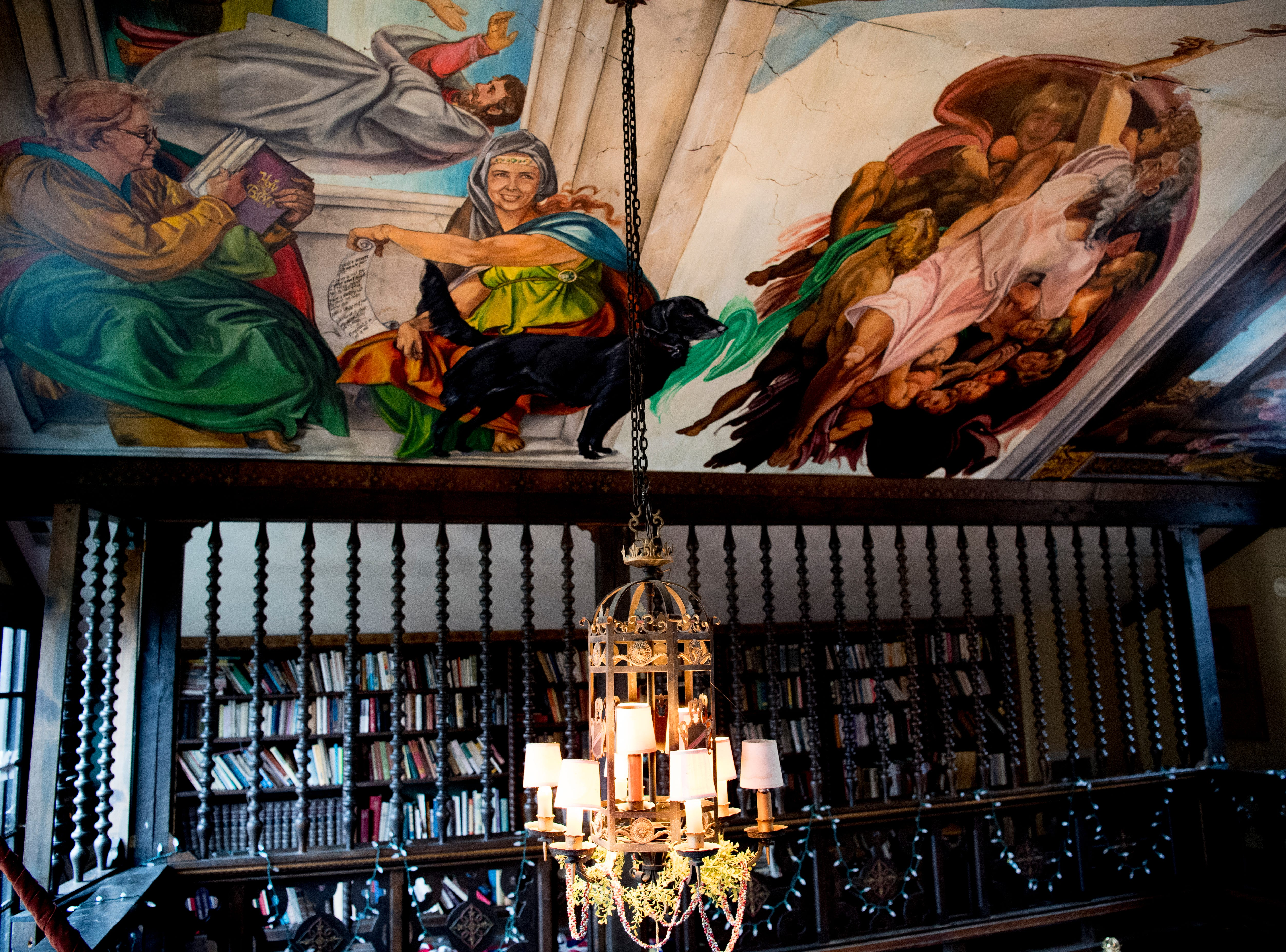 A painted ceiling inside the master bedroom features family members as characters in the paiting inside Williamswood Castle in South Knoxville, Tennessee on Thursday, January 17, 2019. The home, modeled after a medieval castle, was built by Julia Tucker in 1991 and took 6 years to complete. Many of the items in the home were sourced from around the Knoxville area.